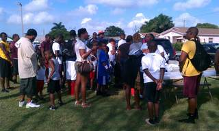 Folks sign up for football clinic in Belle Glade_20110611091404_JPG