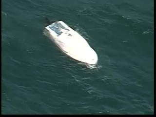 Two rescued from sinking boat