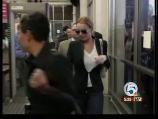 Lindsay Lohan accused of attacking woman