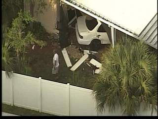 Car crashes in house in suburban West Palm Beach