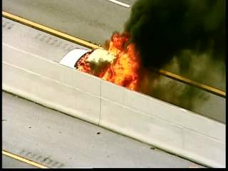 Car fire temporarily blocks I-95