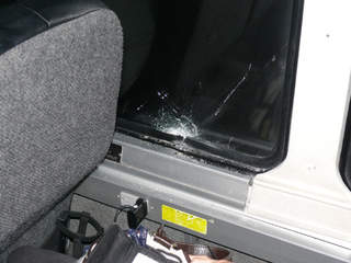 Shattered_window_on_Greyhound_bus_20121230185150_JPG