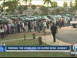 The homeless enjoy a meal and the Super Bowl in downtown West Palm Beach
