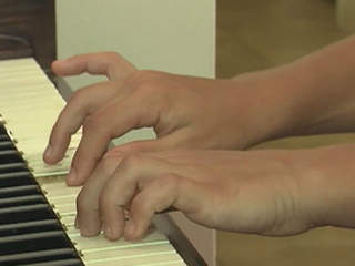 Place of Hope kids getting piano lessons