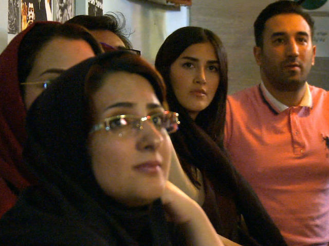 Iranian women defy ban by watching World Cup Sports with men.