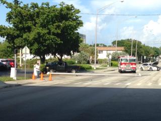 Vehicle hits pole, blocks traffic