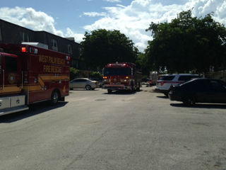 Adult, child hurt in West Palm Beach fire