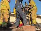 Woman stuck in chimney rescued by fire crews