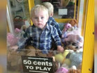 Toddler climbs into toy machine, gets stuck
