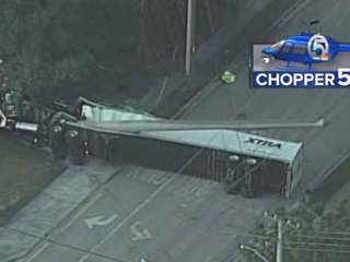 1 dead, 1 hurt after semi hits power lines