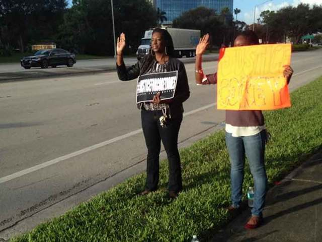 Group Protests Outside Gardens Mall For Black Out Black Friday