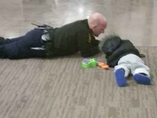 Photo goes viral after officer plays with child
