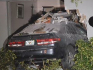 Car plows 20 feet into Lauderhill house