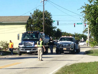Crash knocks down power lines in Lantana