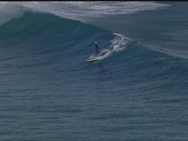CHOPPER 5: Surfers catch some waves off Palm Beach