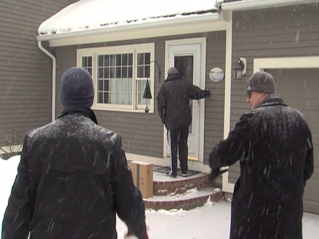Volunteers go through snow for their candidates