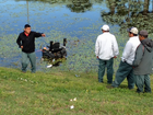 Man falls from riding mower into pond