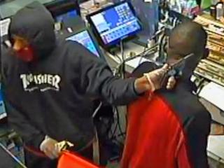 Clerk held at gunpoint; robbery caught on camera - wptv.com