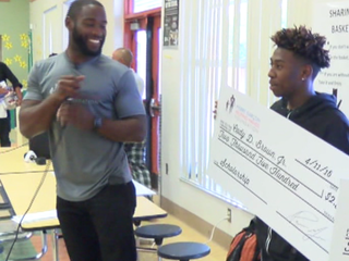 NFL player hands out scholarships in PB County