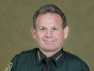 Broward Sheriff struck by vehicle while jogging