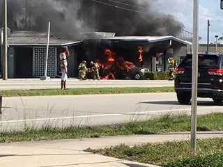 WATCH: Vehicle catches fire at Boca gas station