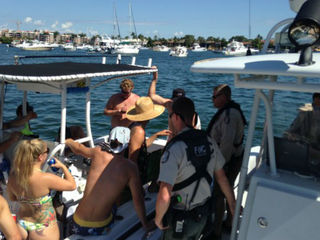 Police arrest five people at Boca Bash