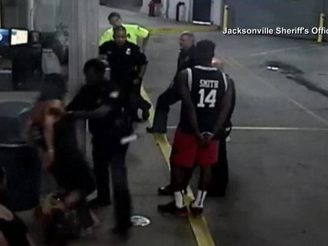 Jacksonville officer arrested after hitting handcuffed woman