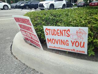 Battling roadside signs in Palm Beach County