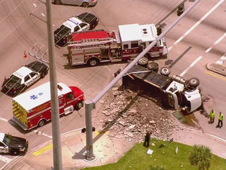 Dump truck overturns in St. Lucie County