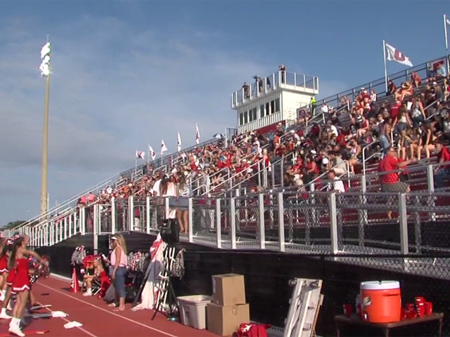 People filling bleachers at Vero Beach High School after repairs
