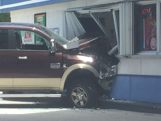 Truck crashes into Lake Worth gas station