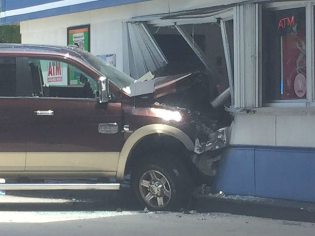 Truck crashes into gas station