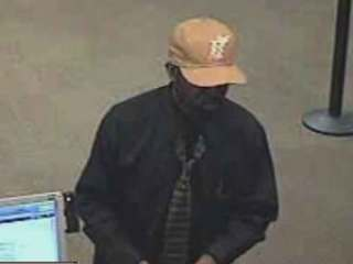 'Ball cap bandit' sought in 10 bank robberies