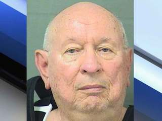 Singer Island man charged with killing wife
