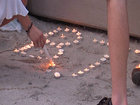 Friends, family hold vigil for slain teen