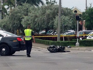 Officer, motorcyclist injured in crash