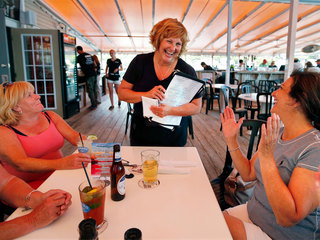 Wife of lowest paid governor takes waitress job