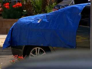 Victim wedged in windshield of moving car