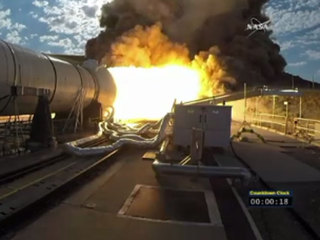 Booster rocket fires in key NASA test for Mars