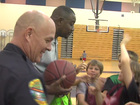 Kids team up with police at basketball camp