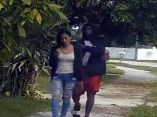Man caught on video robbing woman at gunpoint