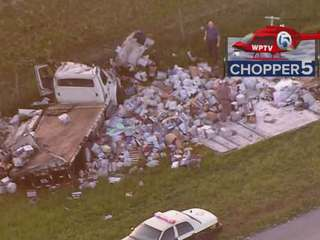 Truck crash on Turnpike spills debris