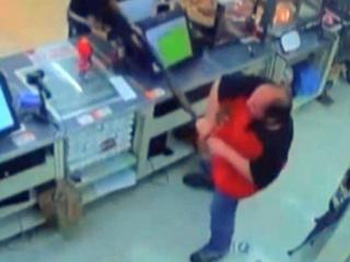 Clerk wrestles gun away from robber