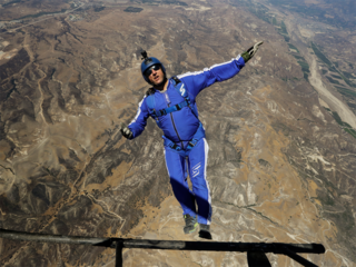 He's a skydiver working with a net, but no chute