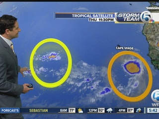 Two tropical waves rapidly moving West