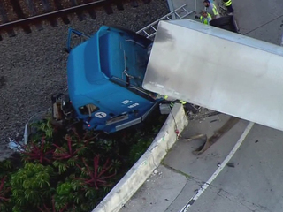 PHOTOS: Semi dangles from I-95 ramp in Boca