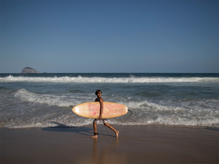 In Rio's slums, kids surf in toxic waters