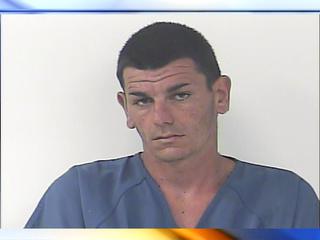 Man wakes up, finds burglar in his bedroom