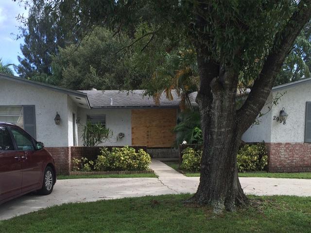 Sheriff: Intruder smashes through window, attacks residents