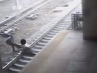 VIDEO: Officer pulls man from tracks